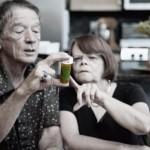 elderly couple examining pills bottle: Phytanna Medical Hemp & Pain Blog