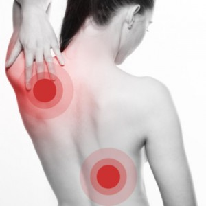 Young-woman-with-shoulder-and-back-pain