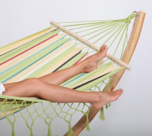 Woman laying in hammock