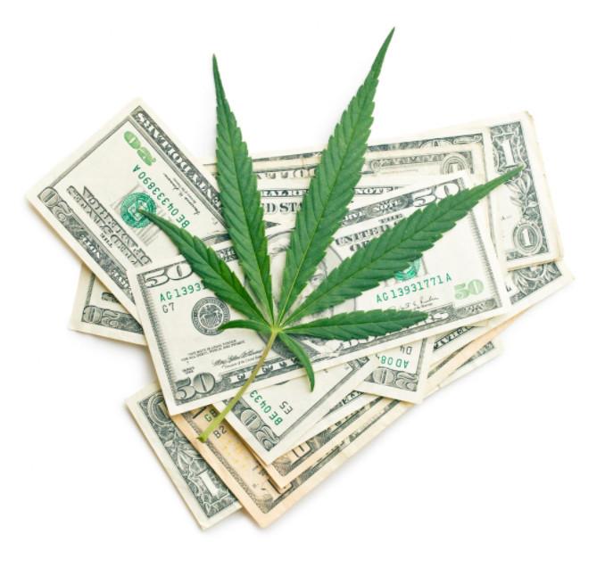 marijuana leaf and money